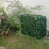 cache clim jardin discret en angle maison