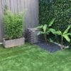 cache climatiseur en bois dans jardin