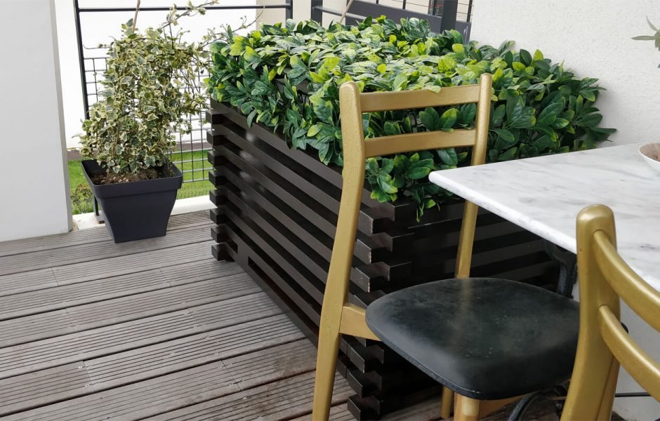 Black Lignea Vegetalis air conditioner cover on wooden terrace