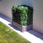 cacher un climatiseur extérieur effet nature